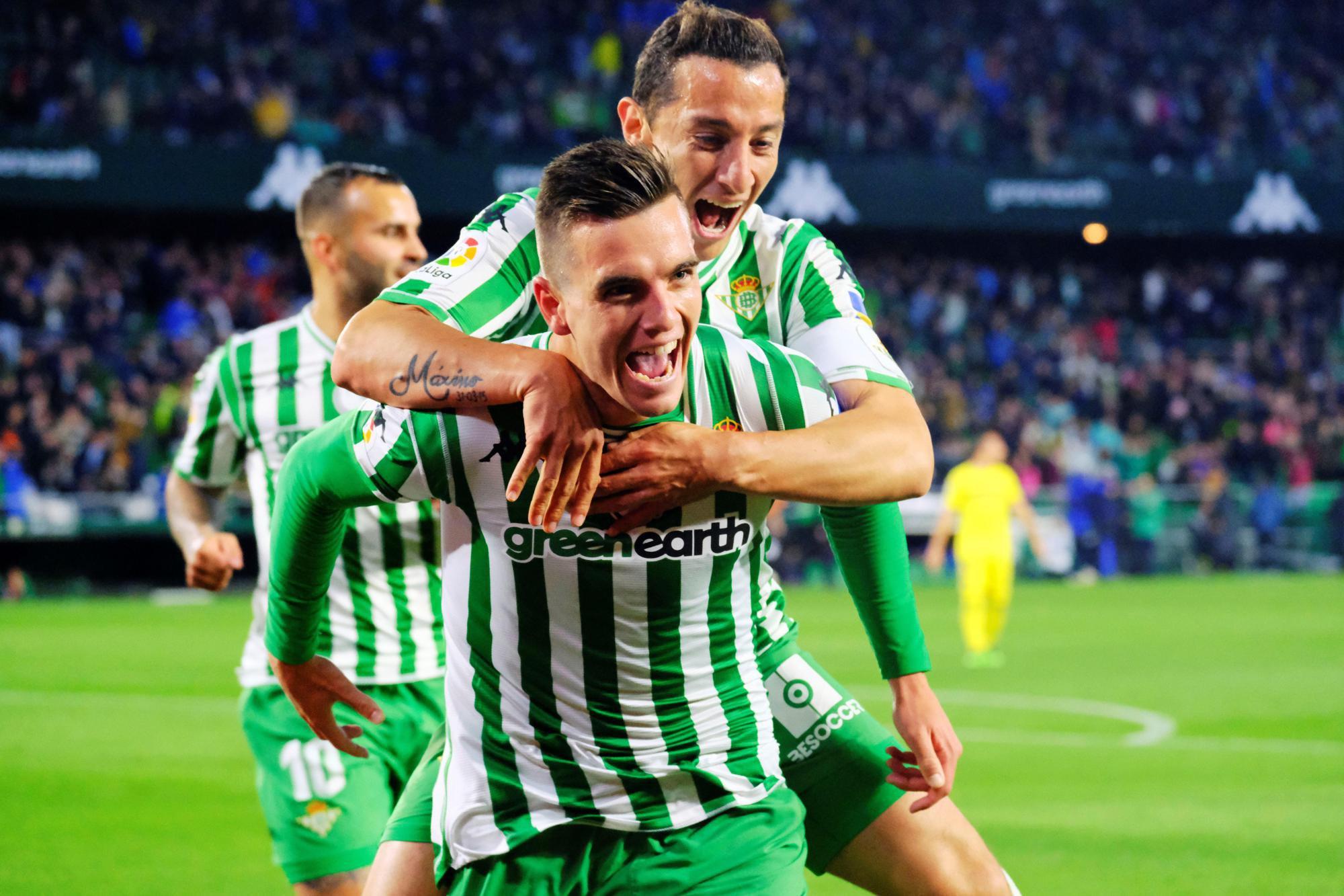 Lo Celso celebrado con Guardado uno de sus dos goles al Villarreal.
